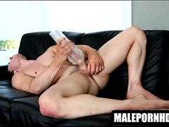 A buff stud is using a toy to masturbate himself
