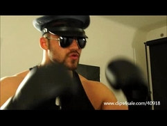 BIG MUSCULAR COP HUNK DOMINATES THE BOXING BAG